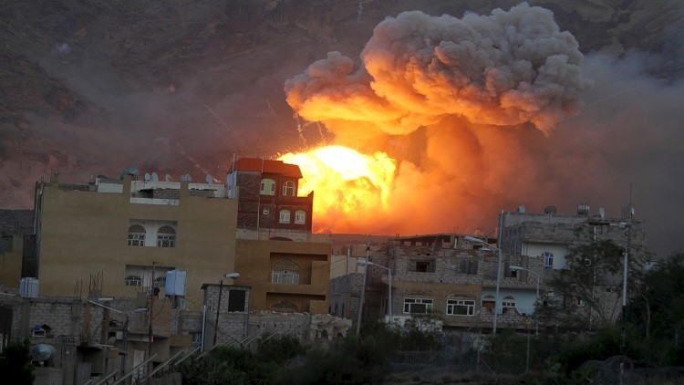 Fire and smoke billows from an army weapons depot after it was hit by an air strike in Yemen's capital Sanaa